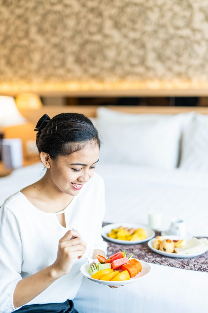 Woman eating nutritious food happily