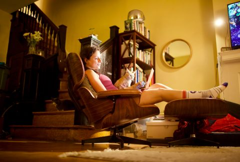 Woman Relaxes with Cat